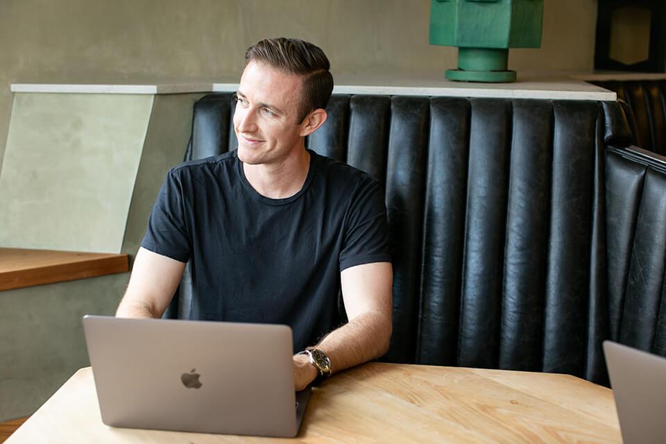 Ryan Robinson Blogging (Head Shot) Photo of Blogger Working at Coffee Shop