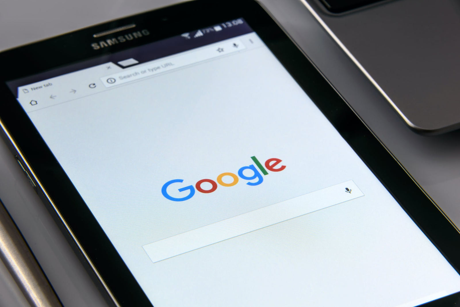 SEO (Search Engine Optimization) Best Practices to Nail Your Blog Marketing Efforts - Image of Phone with Google Open